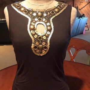 Dark brown sleeveless top with gold/ brass detail